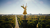 Drone point of view Victory Column and sunny Tiergarten Park, Berlin, Germany