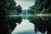 Tranquil Rakotzbruecke Devils Bridge, Rakotzbruecke, Brandenburg, Germany