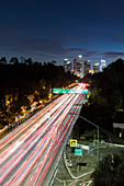 Long exposure cars driving along freeway, Los Angeles, California, USA