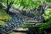 Statues lining steps in temple garden, Honshu island, Japan, Asia