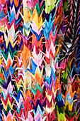 Close up of multicolor origami cranes, Kyoto, Japan