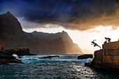 Cape Verde, Island Santo Antao, landscapes, mountains, ocean, coastline, boys diving, sunset