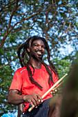 Cape Verde, Island Santiago, rasta man playing drums, music, smile