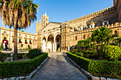 The Cathedral of Palermo with the well-kept garden in the foreground