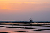 The famous salt mine of Marsala in Sicily at sunset