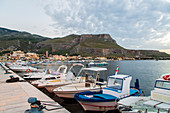 Boats in the evening light in front of Tonnara di Bonagia in Sicily, Italy