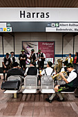 Bavarian folk band plays in the subway on the way to the Oktoberfest, Munich, Bavaria, Germany