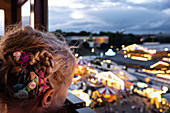 Glimpse of a girl from ferris wheel at the Okroberfest, Munich, Bavaria, Germany