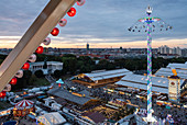 View from the ferris wheel to the Oktoberfest in Munich at sunset, Bavaria, Germany