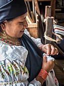 Indigenous woman doing traditional embroidery, Otavalo, Ecuador, South America