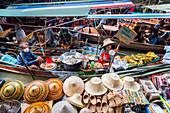 Ladies selling fried bananas at The Damnoen Saduak Floating River Market, Bangkok, Thailand, Southeast Asia, Asia