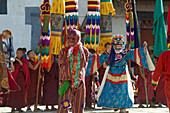 Masked dancers and monks at Mask Dance, feast at Gangteng Monastery, Phobjikha Valley, Bhutan, Himalayas, Asia