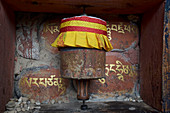 Prayer wheel with the mantra Om Mani Padme Hum in Tibetan scripture in Bumthang Valley, Bhutan, Himalayas, Asia