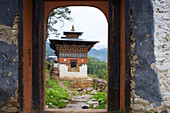 Gate to Chu Dzong below Jakar Dzong in Chamkhar Valley, Bumthang, Bhutan, Himalayas, Asia