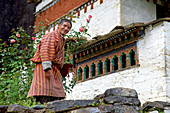 Bhutanese with prayer beads in front of the Ta Rimocen temple, Tang valley, Bumthang, Bhutan, Himalayas, Asia