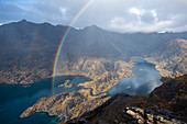 A rainbow above Loch Coruisk and the main Cuillin ridge seen from the top of Sgurr Na Stri on the Isle of Skye, Inner Hebrides, Scotland, United Kingdom, Europe