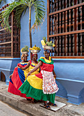 Colourful Palenqueras selling fruits on the street of Cartagena, Bolivar Department, Colombia, South America