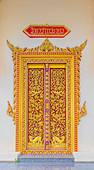 An ornate temple door at the Office of National Buddhism, in Phuket Town, Phuket, Thailand, Southeast Asia, Asia