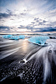 Glaciers washing up on remote beach, Jokulsarlon, Iceland