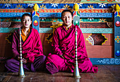 Asian monks sitting on temple floor, Bhutan, Kingdom of Bhutan