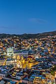 Aerial view of Guanajuato cityscape lit up at night, Guanajuato, Mexico