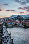 Charles Bridge, Prague Castle and cityscape at sunset, Prague, Czech Republic