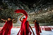 Asian monks dancing in historic temple, Mingun, Mandalay, Myanmar