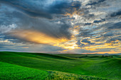 Dramatic sky over rolling hills in rural landscape, USA