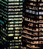 Illuminated highrise buildings at night, USA