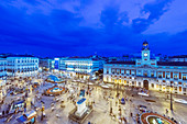 Ornate buildings illuminated at night, Madrid, Spain