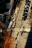 High angle view of bicyclist in city intersection, Vancouver, British Columbia, Canada