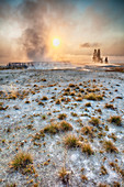 Steam rising from geyser at sunrise, Yellowstone National Park, Wyoming, United States