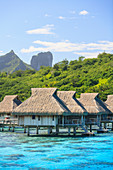 Bungalows over tropical ocean, Bora Bora, French Polynesia