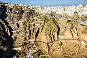Aerial view of city built on rocky hilltop, Oia, Egeo, Greece