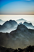 Fog rolling over rocky mountains, Huangshan, Anhui, China,