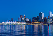 Waterfront skyline illuminated at night, Vancouver, British Columbia, Canada,