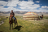 Kirgise on horse in front of yurt, Pamir, Afghanistan, Asia