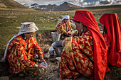 Kyrgyz women washing dishes, Pamir, Afghanistan, Asia