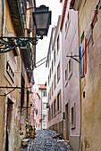 Small alley in Alfama, Lisbon, Portugal