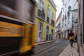 traditional tram in narrow street, Alfama, Lisbon, Portugal