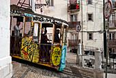 Tourists in the carriage of the Elevador da Bica, Rua da Bica de Duarte Belo, Lisbon, Portugal