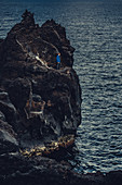Man stands on a cliff on the island Pico, Pico, Azores, Portugal, Atlantic, Europe