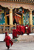 Young Buddhist monks leave the Punakha Dzong, Bhutan