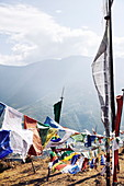 Prayer flags strung high in the mountains above Thimphu, Bhutan