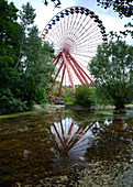 Overgrown ferris wheel in the disused amusement park in the Plänterwald, Treptow, Berlin, Germany