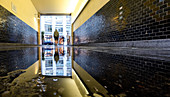 Reflection of the access passage into a courtyard in the Hackeschen Höfe, Mitte, Berlin, Germany