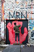 Street artist at work at the former radar station on Teufelsberg, Grunewald; Berlin; Germany;