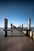 View of the old wooden footbridge on the Baltic Sea beach of Zingst, Mecklenburg-West Pomerania, Germany