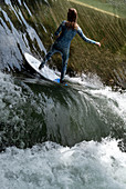 Isar surfer on the wave in Thalkirchen, Munich, Bavaria, Germany