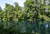 View of a canoeist on the Isar Canal, Munich, Bavaria, Germany